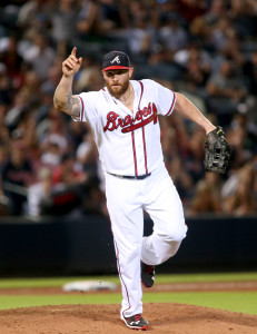 Aug 28, 2015; Atlanta, GA, USA; Atlanta Braves left fielder Jonny Gomes (7) reacts after getting a strike out after pitching in the ninth inning of their game against the New York Yankees at Turner Field. The Yankees won 15-4. Mandatory Credit: Jason Getz-USA TODAY Sports