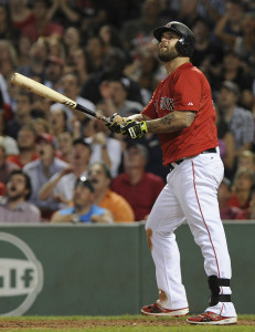 Jul 31, 2015; Boston, MA, USA; Boston Red Sox first baseman Mike Napoli (12) watches his home run land in the green monster seats during the seventh inning against the Tampa Bay Rays at Fenway Park. Mandatory Credit: Bob DeChiara-USA TODAY Sports