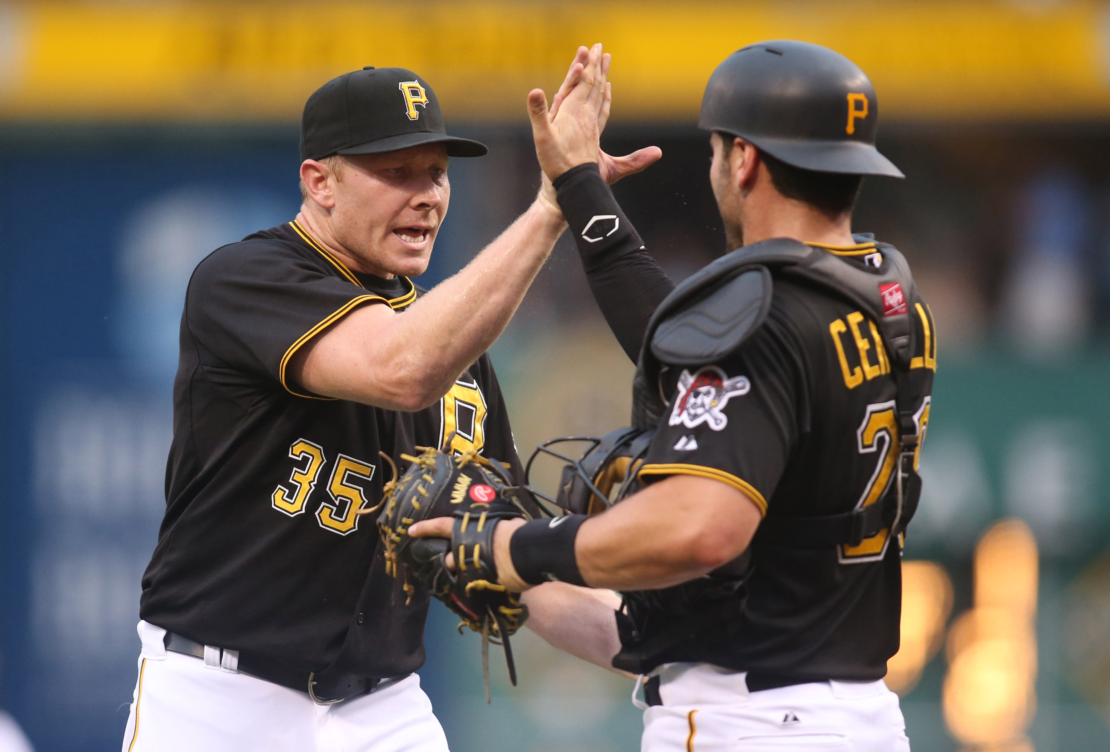 Aug 8, 2015; Pittsburgh, PA, USA; Pittsburgh Pirates relief pitcher Mark Melancon (35) and catcher Francisco Cervelli (29) celebrate after defeating the Los Angeles Dodgers at PNC Park. The Pirates won 6-5. Mandatory Credit: Charles LeClaire-USA TODAY Sports