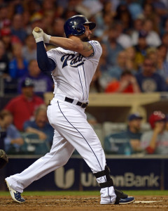 Aug 11, 2015; San Diego, CA, USA; San Diego Padres first baseman Yonder Alonso (23) hits a two RBI double during the second inning against the Cincinnati Reds at Petco Park. Mandatory Credit: Jake Roth-USA TODAY Sports
