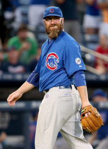 Jul 19, 2015; Atlanta, GA, USA; Chicago Cubs relief pitcher Jason Motte (30) reacts after the final out during their win over the Atlanta Braves at Turner Field. The Cubs won 4-1. Mandatory Credit: Jason Getz-USA TODAY Sports
