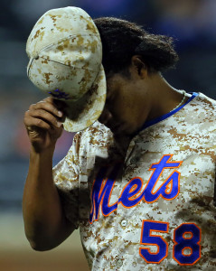 Sep 15, 2014; New York, NY, USA; New York Mets relief pitcher Jenrry Mejia (58) reacts walking to the dugout against the Miami Marlins during the eighth inning at Citi Field. Mandatory Credit: Adam Hunger-USA TODAY Sports