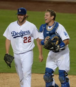 Sep 24, 2014; Los Angeles, CA, USA; Los Angeles Dodgers starting pitcher Clayton Kershaw (22) and Los Angeles Dodgers catcher A.J. Ellis (17) walk off the field after the last out of the eighth inning against the San Francisco Giants at Dodger Stadium. The Los Angeles Dodgers defeated the San Francisco Giants 9-1 to clinch the NL West Division Championship. Mandatory Credit: Jayne Kamin-Oncea-USA TODAY Sports