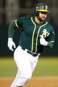May 6, 2017; Oakland, CA, USA; Oakland Athletics first baseman Yonder Alonso (17) rounds third base after hitting a two run home run against the Detroit Tigers during the sixth inning at Oakland Coliseum. Mandatory Credit: Stan Szeto-USA TODAY Sports