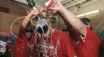 Sep 30, 2017; Boston, MA, USA; Boston Red Sox starting pitcher Chris Sale (41) has champagne poured on him by his teammates after clinching the American League East against the Houston Astros at Fenway Park. Mandatory Credit: Bob DeChiara-USA TODAY Sports