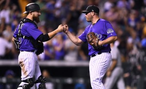 Aug 18, 2017; Denver, CO, USA; Colorado Rockies catcher Jonathan Lucroy (21) and relief pitcher Greg Holland (56) celebrate the win over the at Coors Field. Mandatory Credit: Ron Chenoy-USA TODAY Sports