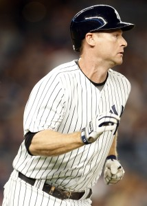 Sep 14, 2017; Bronx, NY, USA; New York Yankees third baseman Chase Headley (12) watches his RBI single against the Baltimore Orioles during the first inning at Yankee Stadium. Mandatory Credit: Adam Hunger-USA TODAY Sports