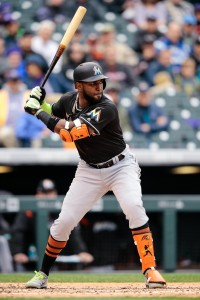 Sep 27, 2017; Denver, CO, USA; Miami Marlins left fielder Marcell Ozuna (13) bats in the fourth inning against the Colorado Rockies at Coors Field. Mandatory Credit: Isaiah J. Downing-USA TODAY Sports