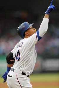Sep 2, 2017; Arlington, TX, USA; Texas Rangers center fielder Carlos Gomez (14) points to the sky as he runs home on his solo home run against the Los Angeles Angels during a baseball game at Globe Life Park in Arlington. Mandatory Credit: Jim Cowsert-USA TODAY Sports